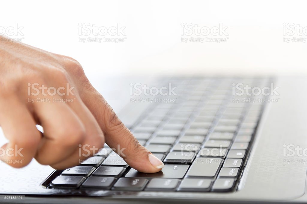 Press enter on laptop stock photo