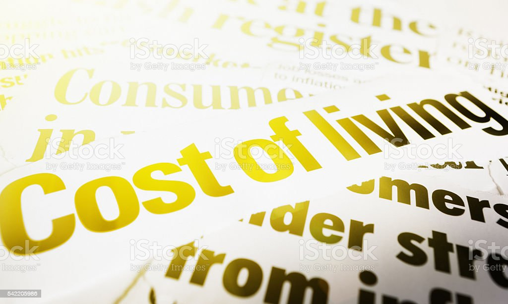 Press headlines on cost of living, inflation, and consumerism stock photo