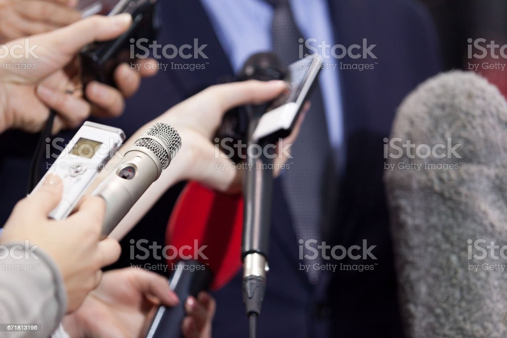 Press interview. News conference. Microphones. stock photo