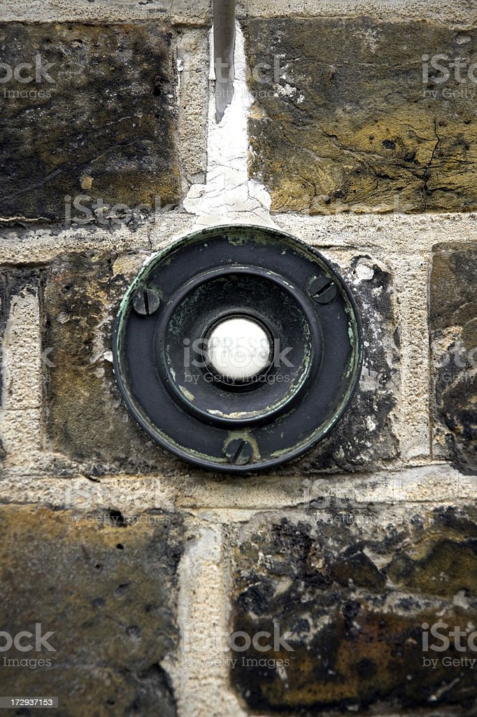 Press - old fashioned bell push on brick wall stock photo