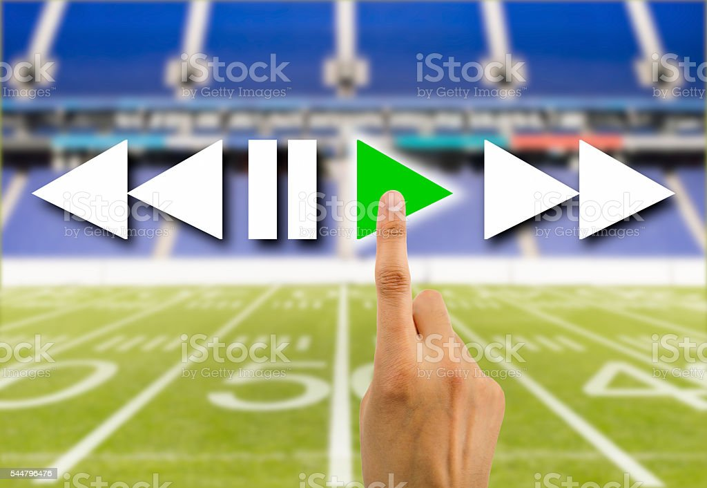 press play button in football rugby stock photo