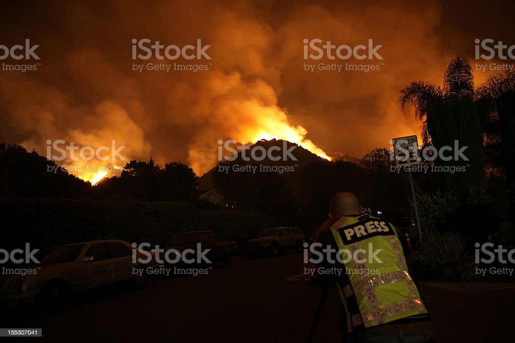Press Takes Picture of Fire on Scene royalty-free stock photo