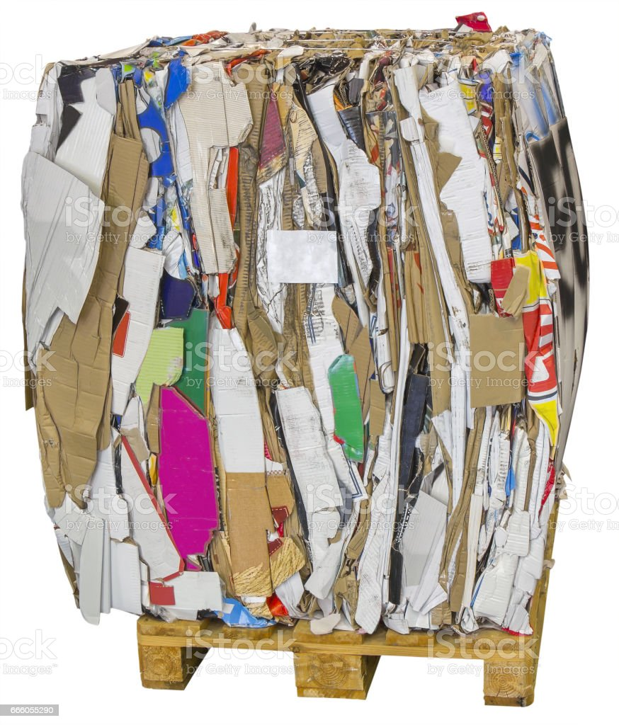Pressed boxes made of paperboard prepared for recycling on wooden pallets stock photo