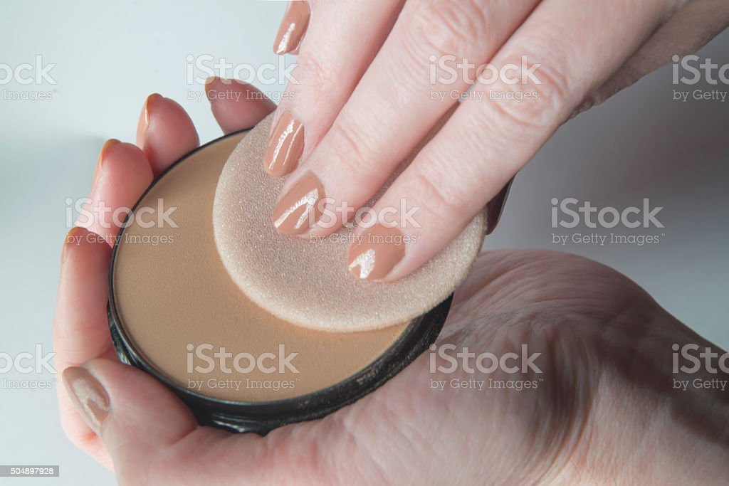 Pressed Face Powder and Puff stock photo