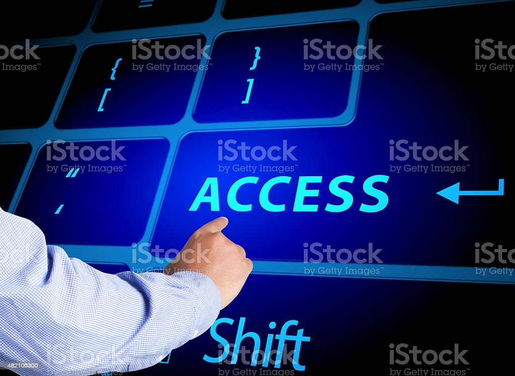 Pressing access button on computer keyboard stock photo