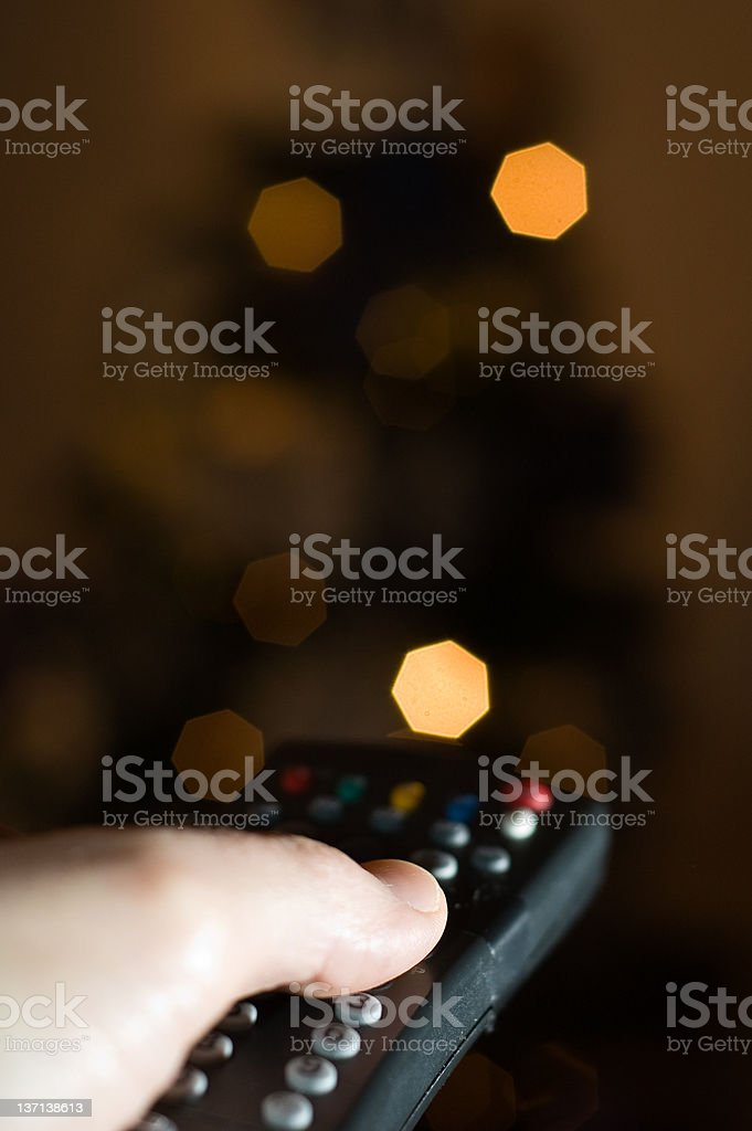 Pressing button on remote control royalty-free stock photo