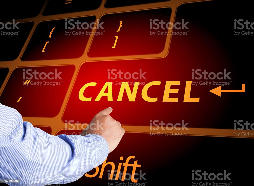 pressing cancel button on computer keyboard stock photo