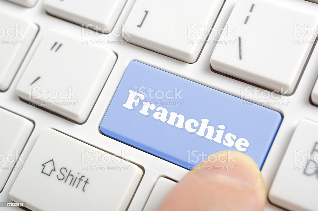 Pressing franchise key on keyboard stock photo