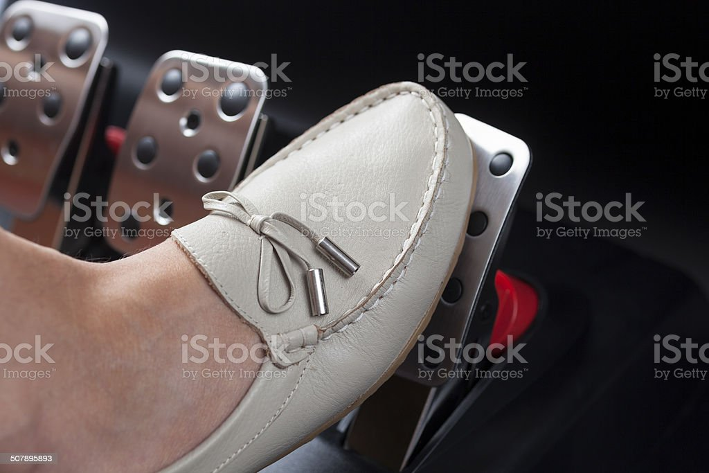 Pressing gas pedal stock photo