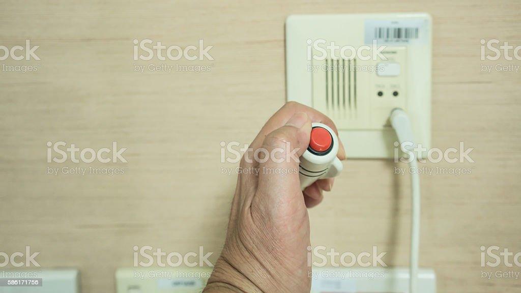 Pressing Nurse Call Button stock photo