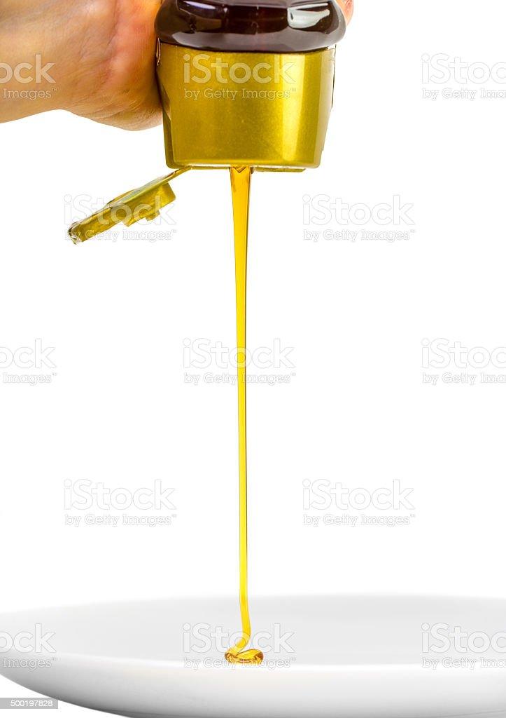 pressing plastic bottle with honey isolated stock photo