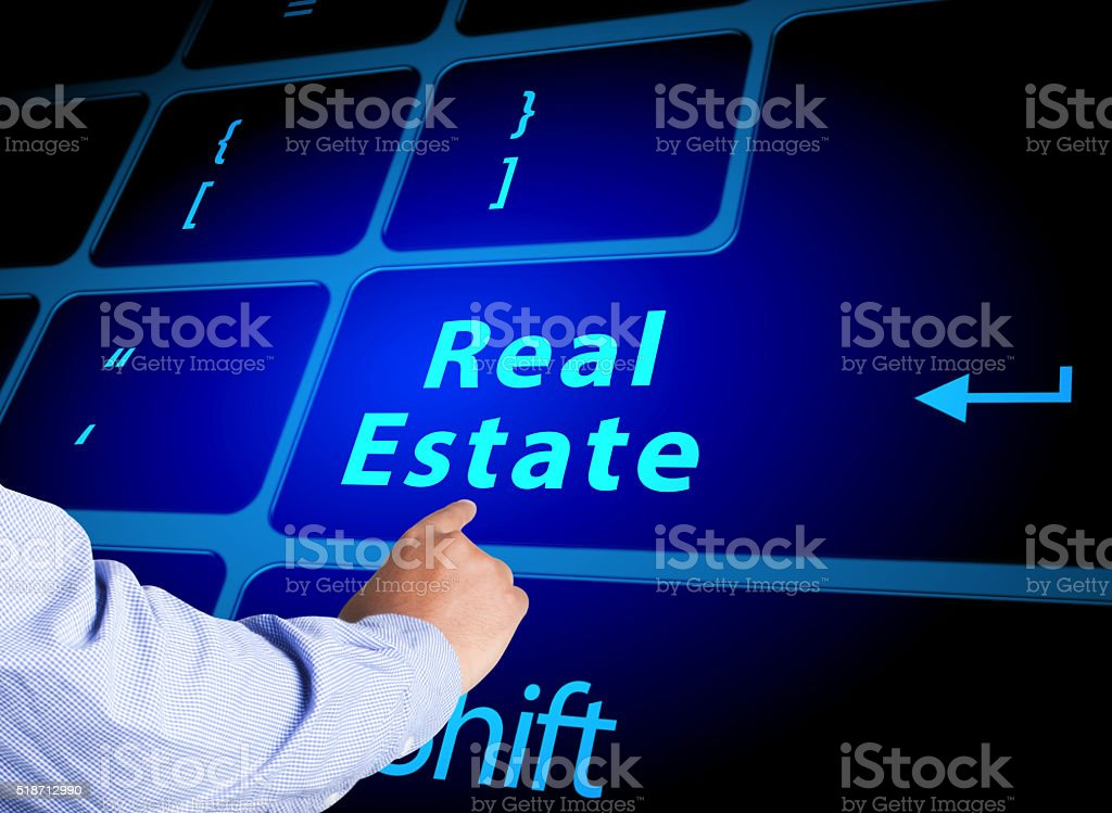 Pressing Real Estate button on computer keyboard stock photo