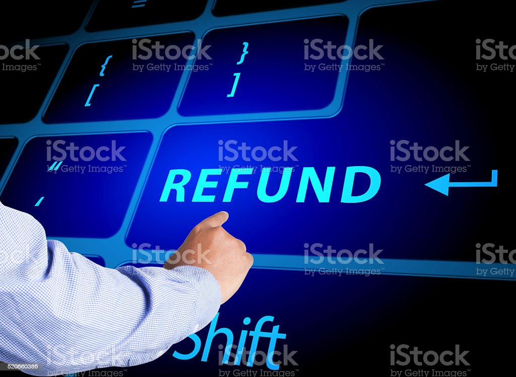 Pressing refund button on computer keyboard stock photo