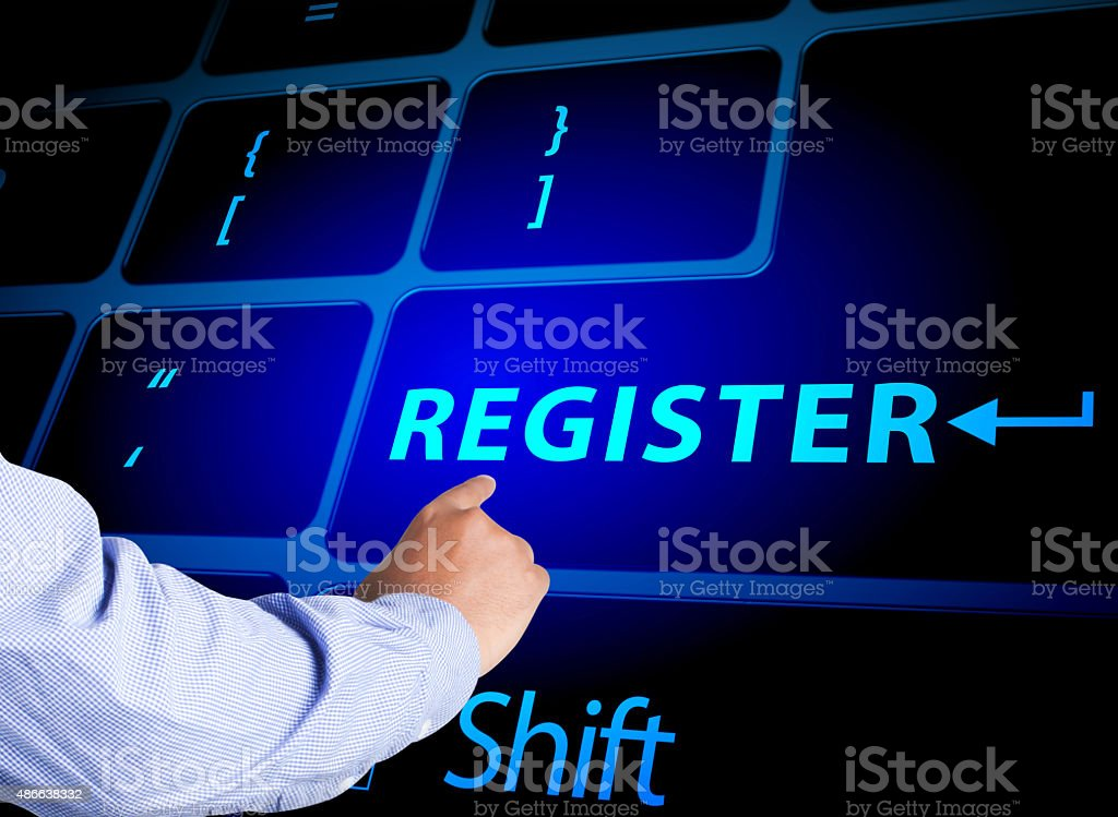 Pressing register button on computer keyboard stock photo