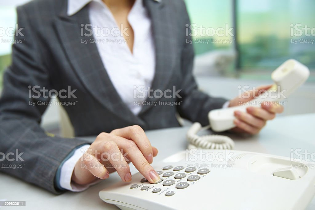 Pressing telephone buttons stock photo