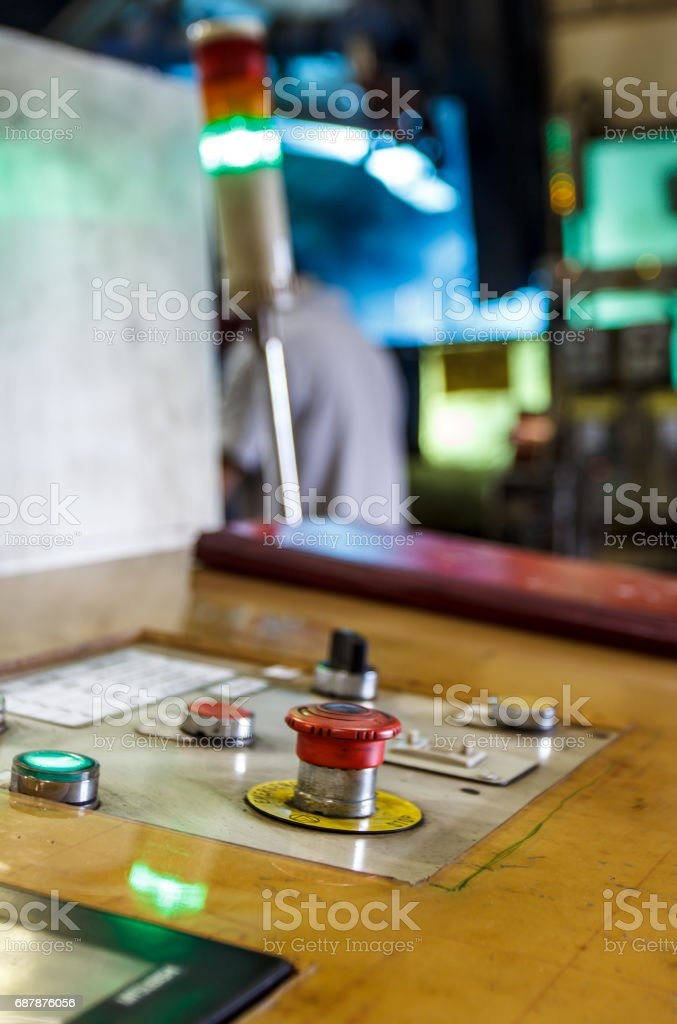 Pressing the emergency stop button stock photo