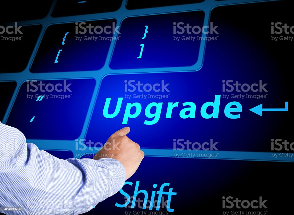 Pressing upgrade button on computer keyboard stock photo
