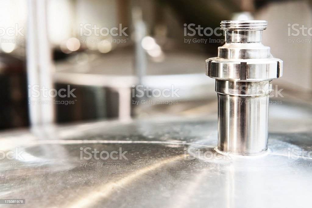 Pressure closure on a stainless steel tank at winery royalty-free stock photo