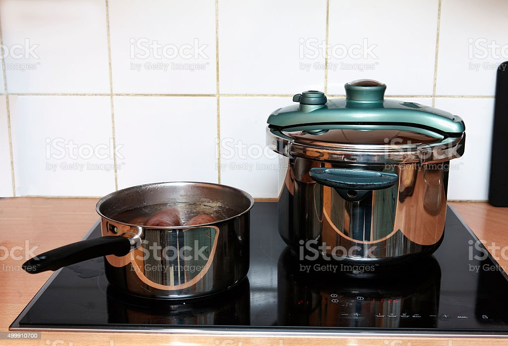 pressure cooker and pan stock photo