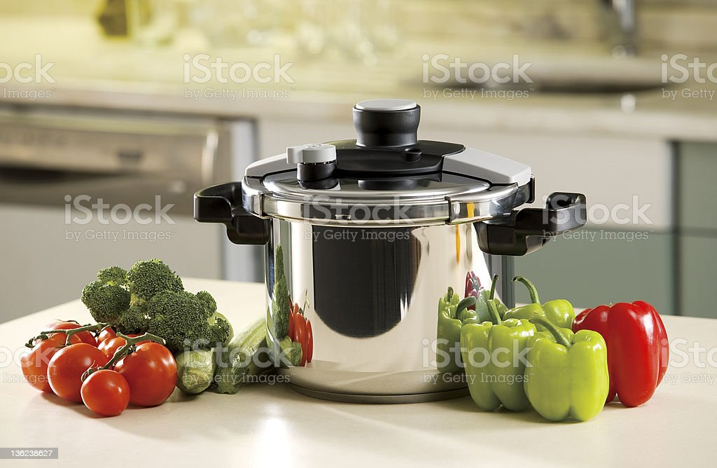 pressure cooker and vegetables stock photo