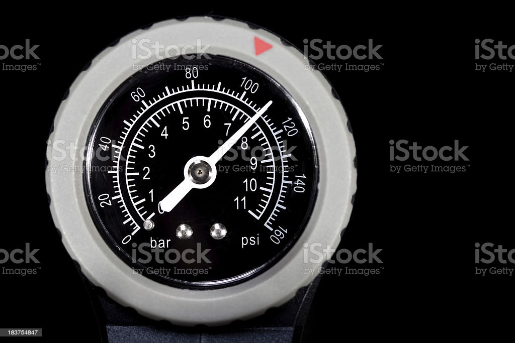Pressure Gauge Dial at 110 Black background royalty-free stock photo