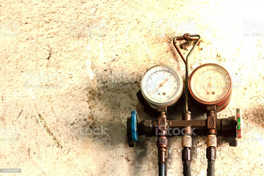 Pressure gauge for measuring pressure system in vintage style stock photo