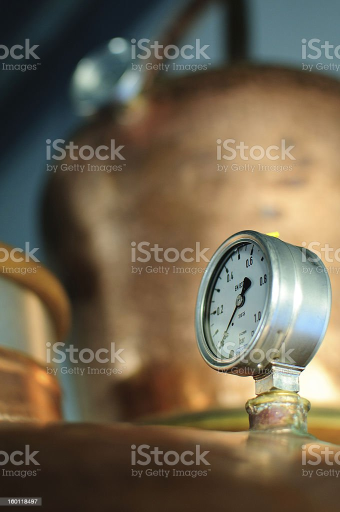 Pressure gauge in front of a distillery tank stock photo