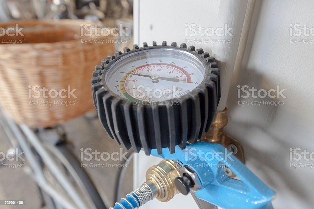 pressure gauge on a bicycle pump stock photo