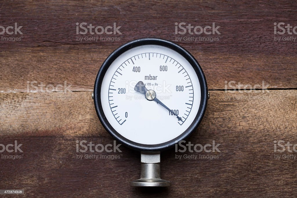 pressure gauge on wood background stock photo