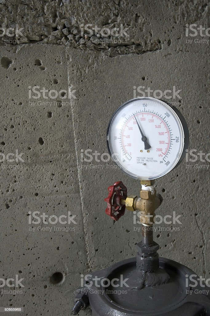 Pressure Gauge with concrete wall royalty-free stock photo