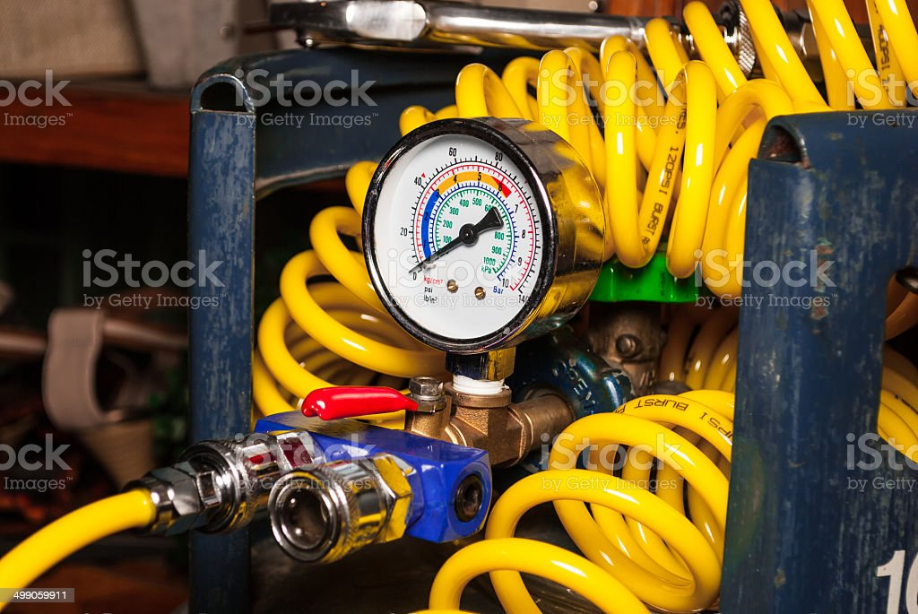 Pressure Guage on Empty Air Tank with Spiral Air Tube stock photo