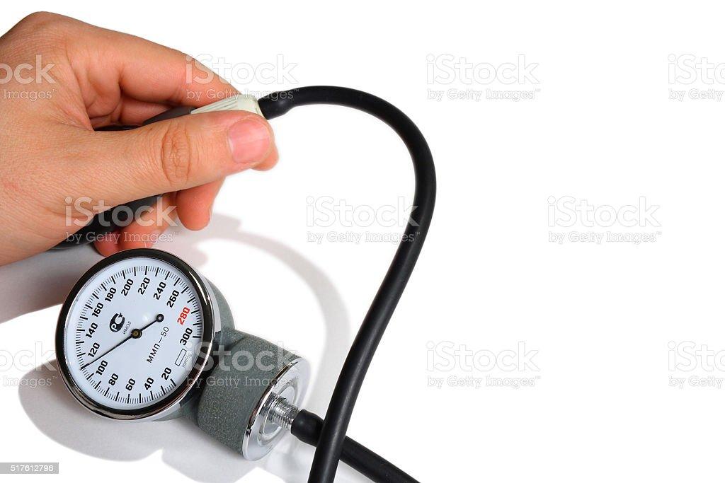 pressure measurement tonometer and hand stock photo