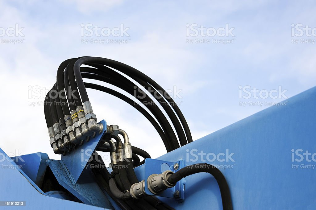 Pressure pipe and hose to the hydraulic an excavator stock photo