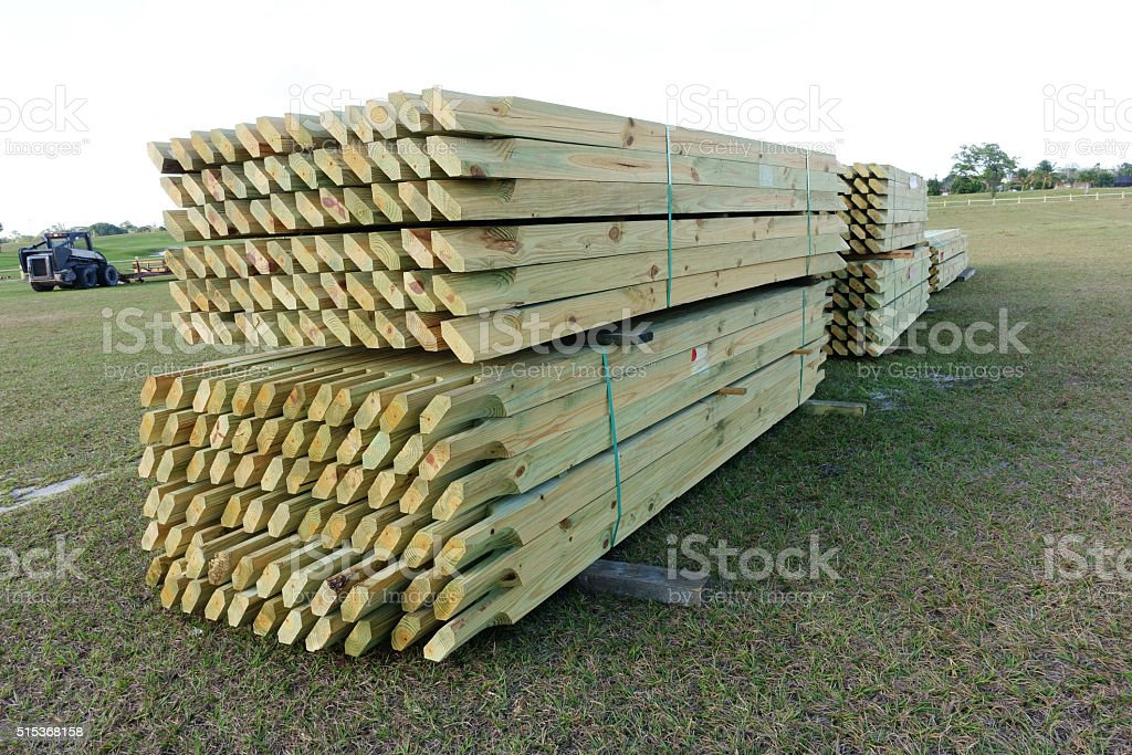 Pressure treated wood fence rails stock photo