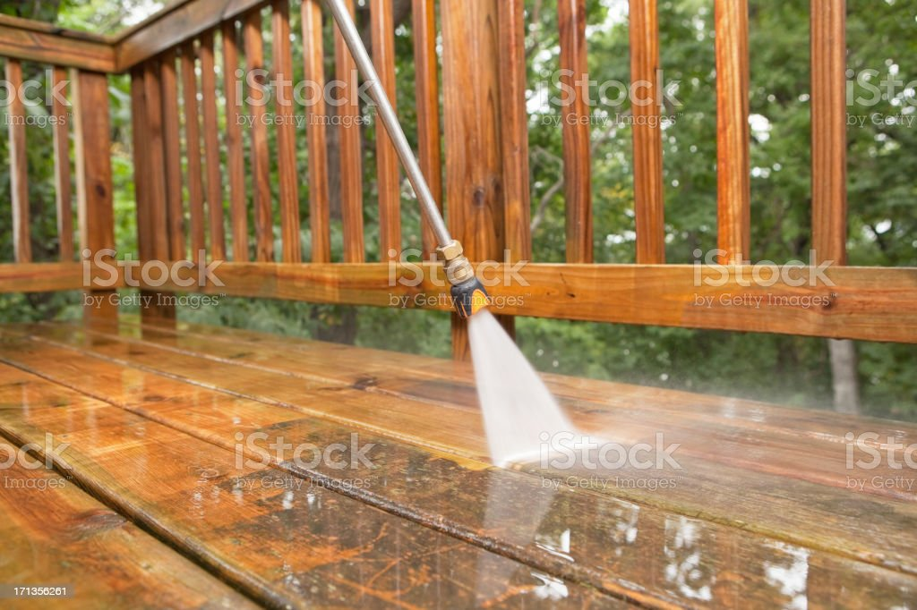 Pressure Washer Cleaning a Weathered Deck royalty-free stock photo