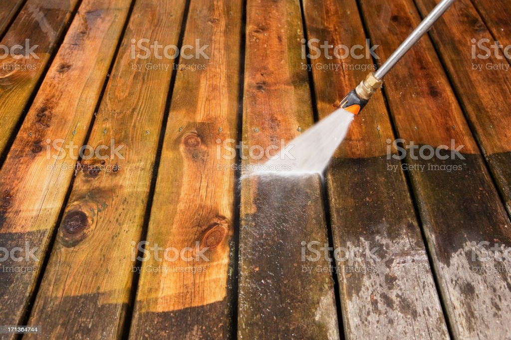 Pressure Washer Cleaning a Weathered Deck stock photo