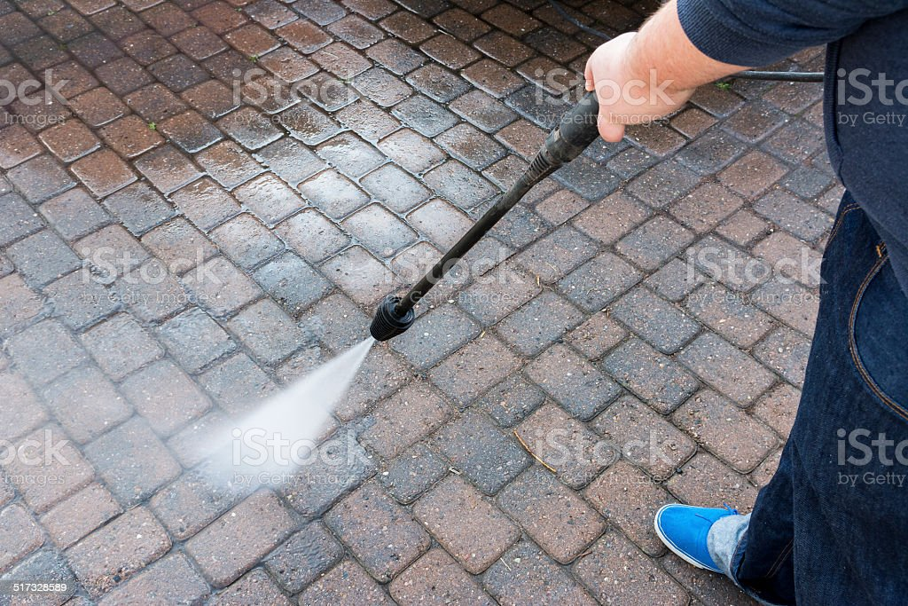 Pressure washer courtyard with paving stone stock photo