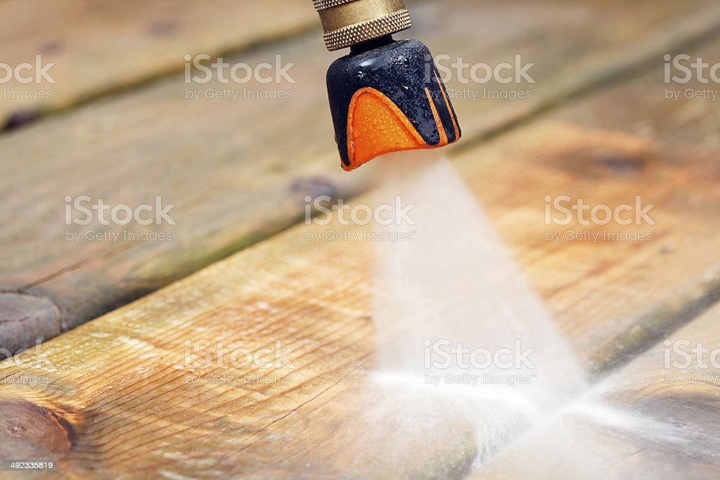 Pressure Washer Spray Nozzle Cleaning Deck Boards royalty-free stock photo