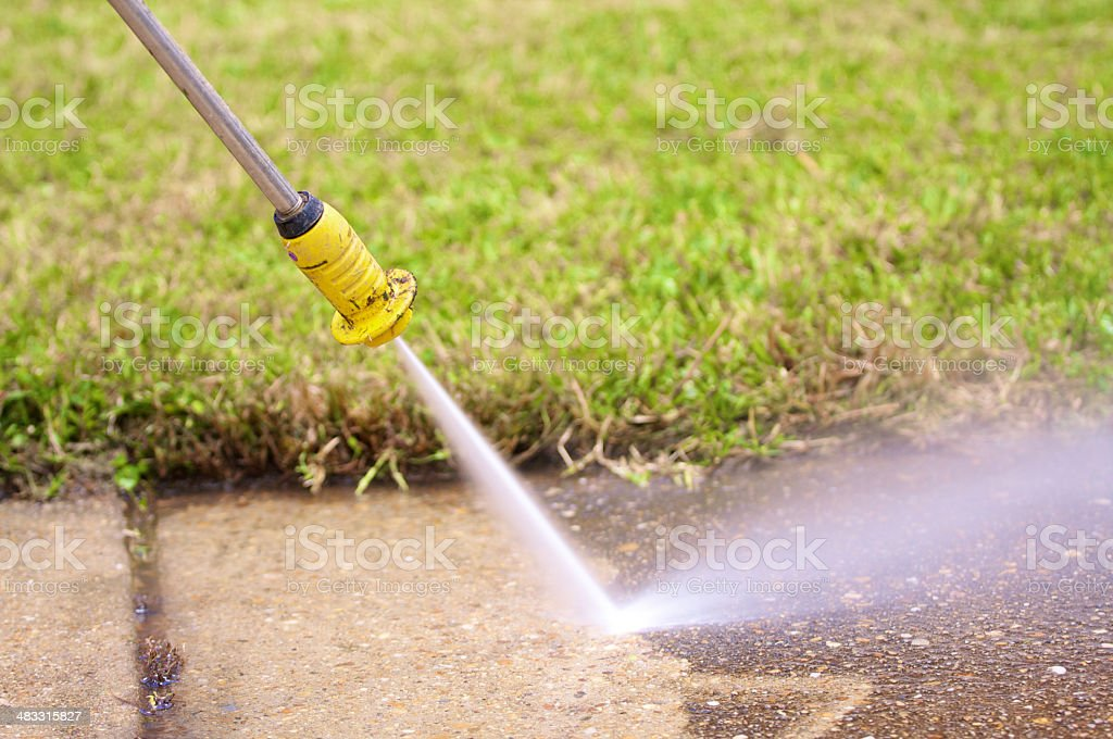 pressure washing a sidewalk royalty-free stock photo