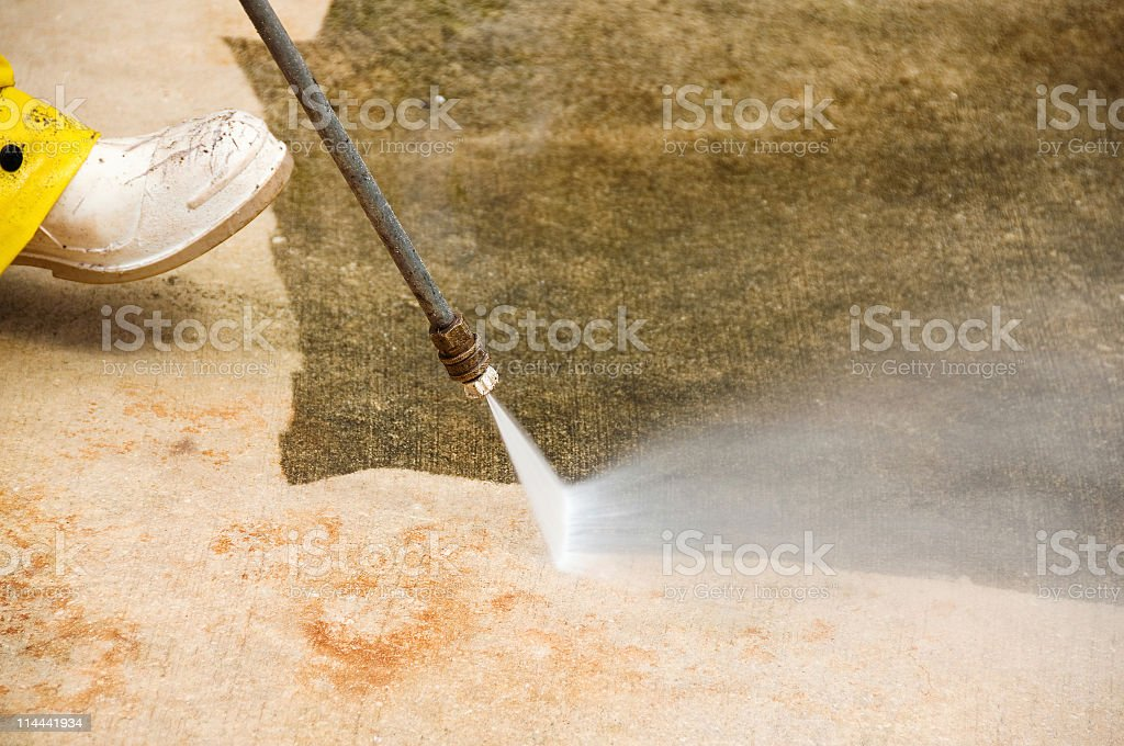 Pressure washing concrete floor royalty-free stock photo