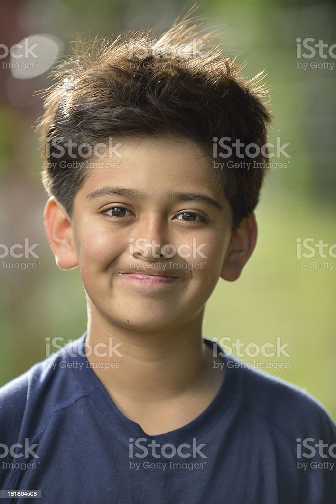 Preteen boy making a face outdoors royalty-free stock photo