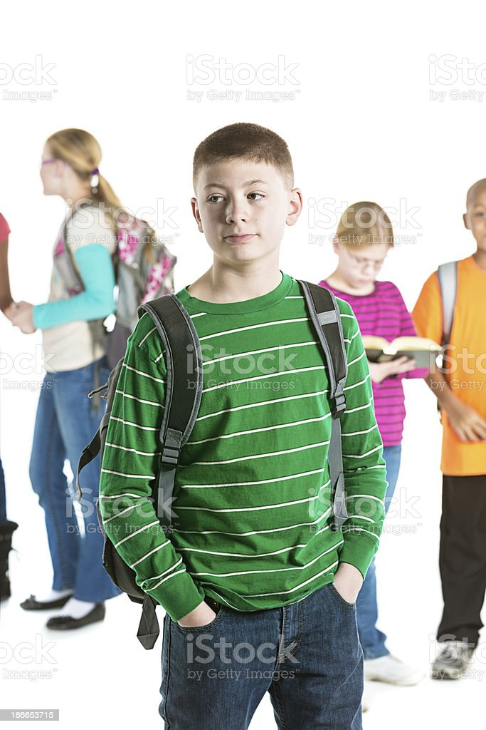 Preteen Boy With Group of Students in Background royalty-free stock photo