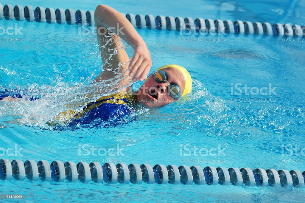 Preteen Female Freestyle Front Crawl Stroke Swimmer in Race royalty-free stock photo