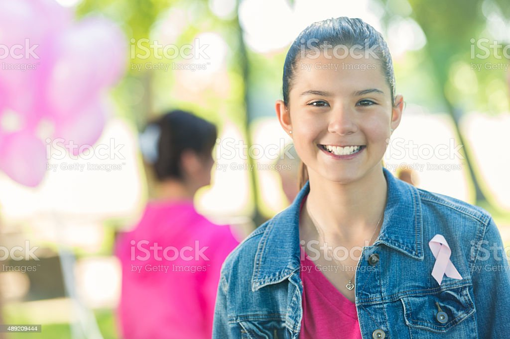 Preteen girl attending event, raising money for breast cancer research stock photo