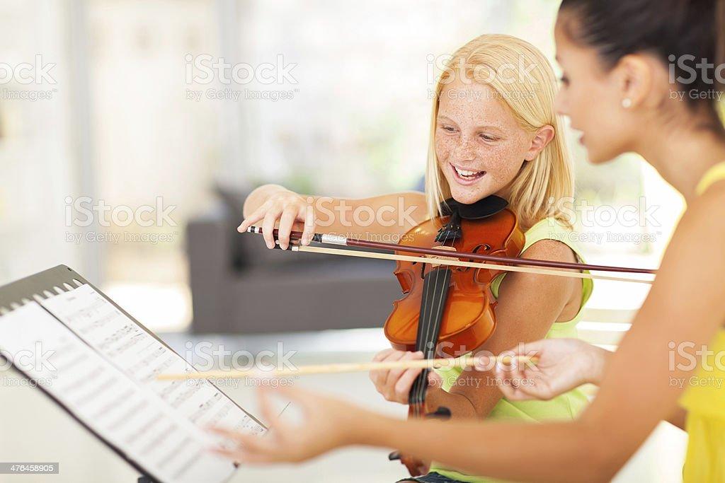 preteen girl in music class stock photo