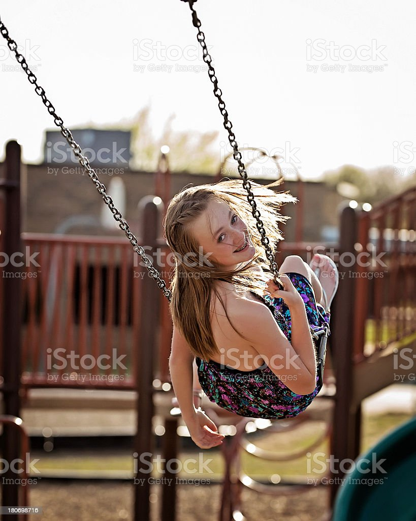 Pre-teen girl on swing royalty-free stock photo