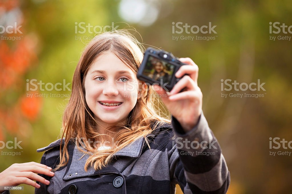 Preteen Girl Taking A Selfie stock photo