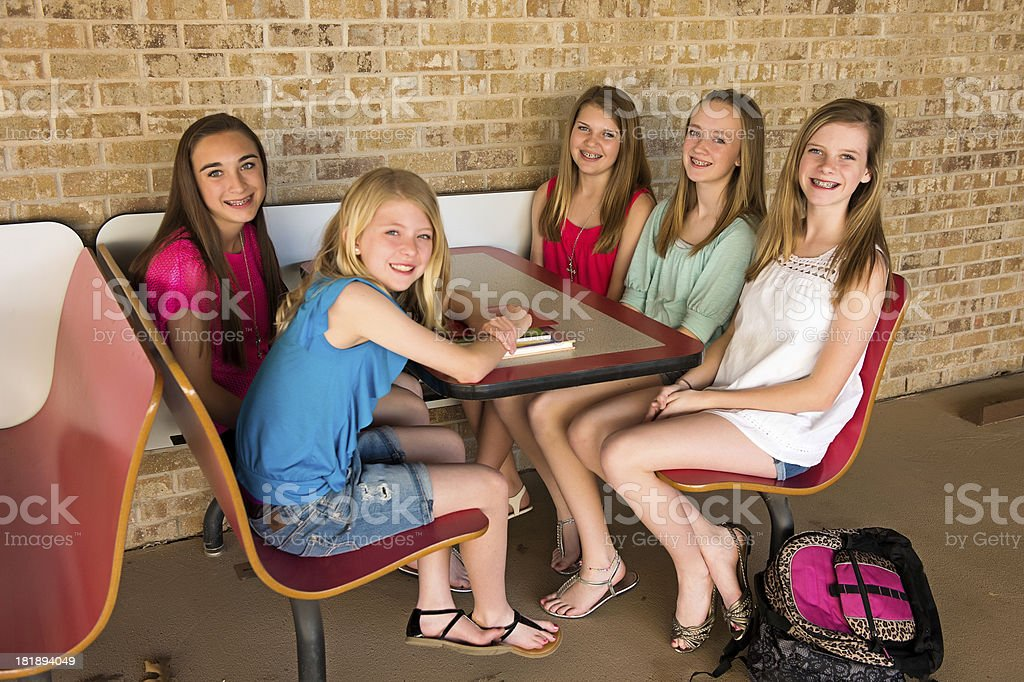 Pre-teen girls at table royalty-free stock photo