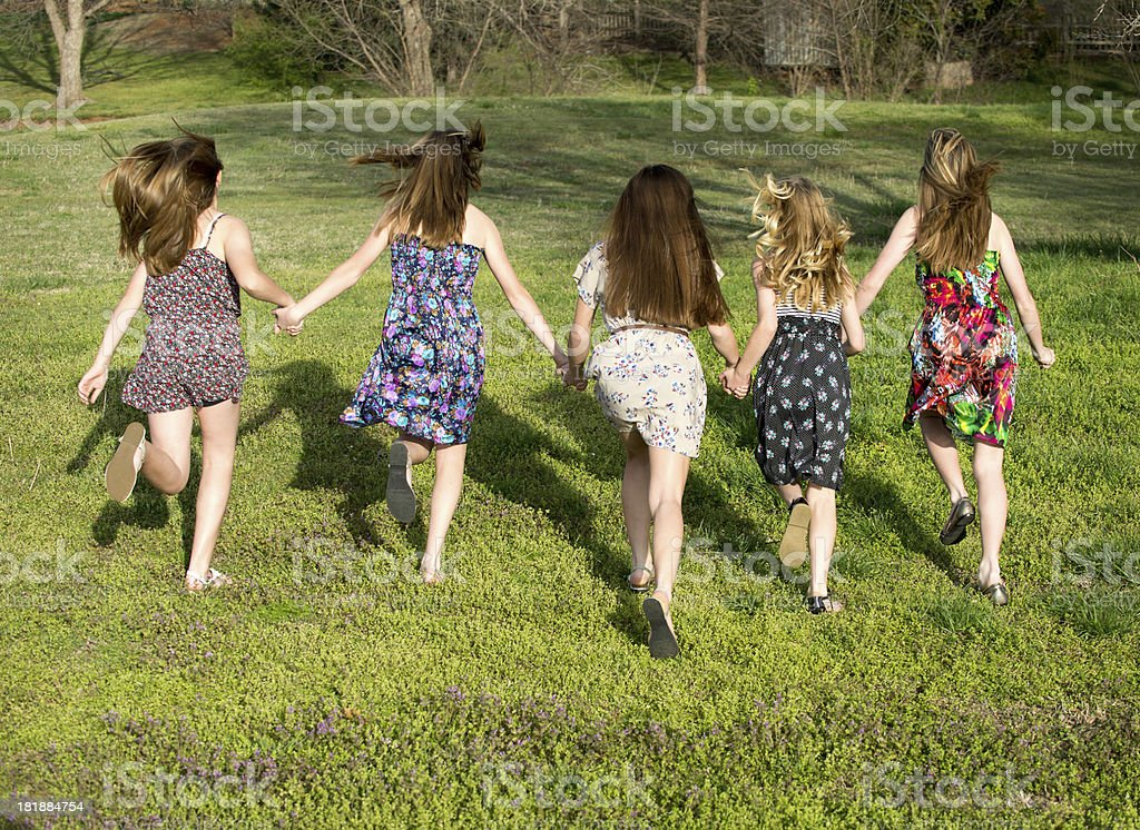 Pre-teen girls running royalty-free stock photo