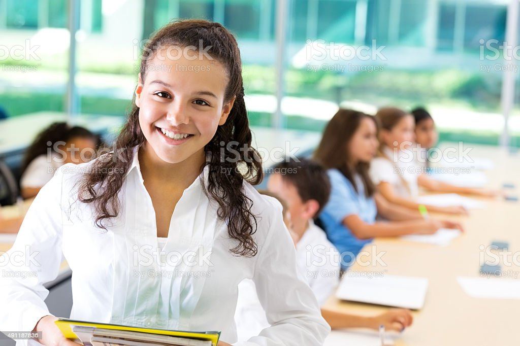 Preteen junior high school student in private middle school classroom stock photo